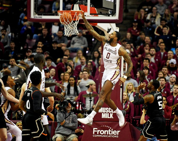 Jan 9, 2019; Tallahassee, FL, USA; Florida State Seminoles forward Phil Cofer (0) dunks the ball during the first half against the Miami Hurricanes at Donald L. Tucker Center. Mandatory Credit: Melina Myers-USA TODAY Sports