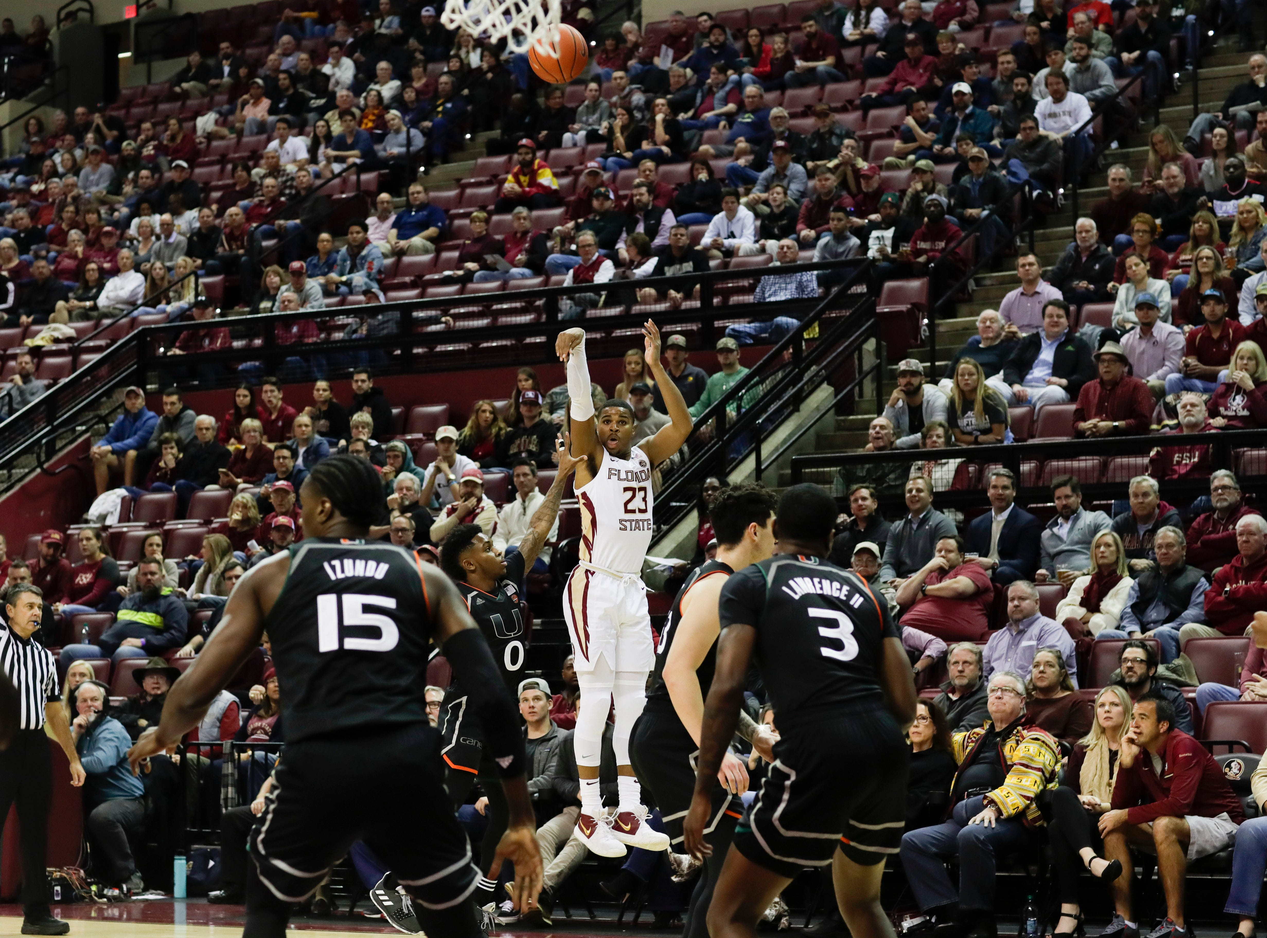 Florida State Seminoles guard M.J. Walker (23) shoots a three during a game between FSU and University of Miami Wednesday, Jan. 9, 2019.