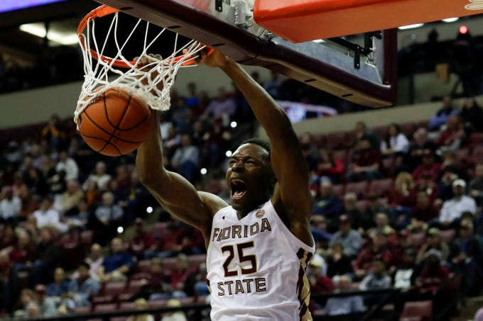 Florida State University's Mfiondu Kabengele (25) dunks during a game between FSU and University of Miami at the Donald L. Tucker Civic Center Wednesday, Jan. 9, 2019.