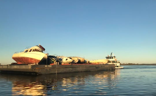 A few of the 11 derelict boats removed from the waters of Franklin and Wakulla counties following Hurricane Michael are headed out to sea on the St. Marks River on Sunday Jan. 6. In all, 544 boats were removed by state and federal officials across the Florida Panhandle.
