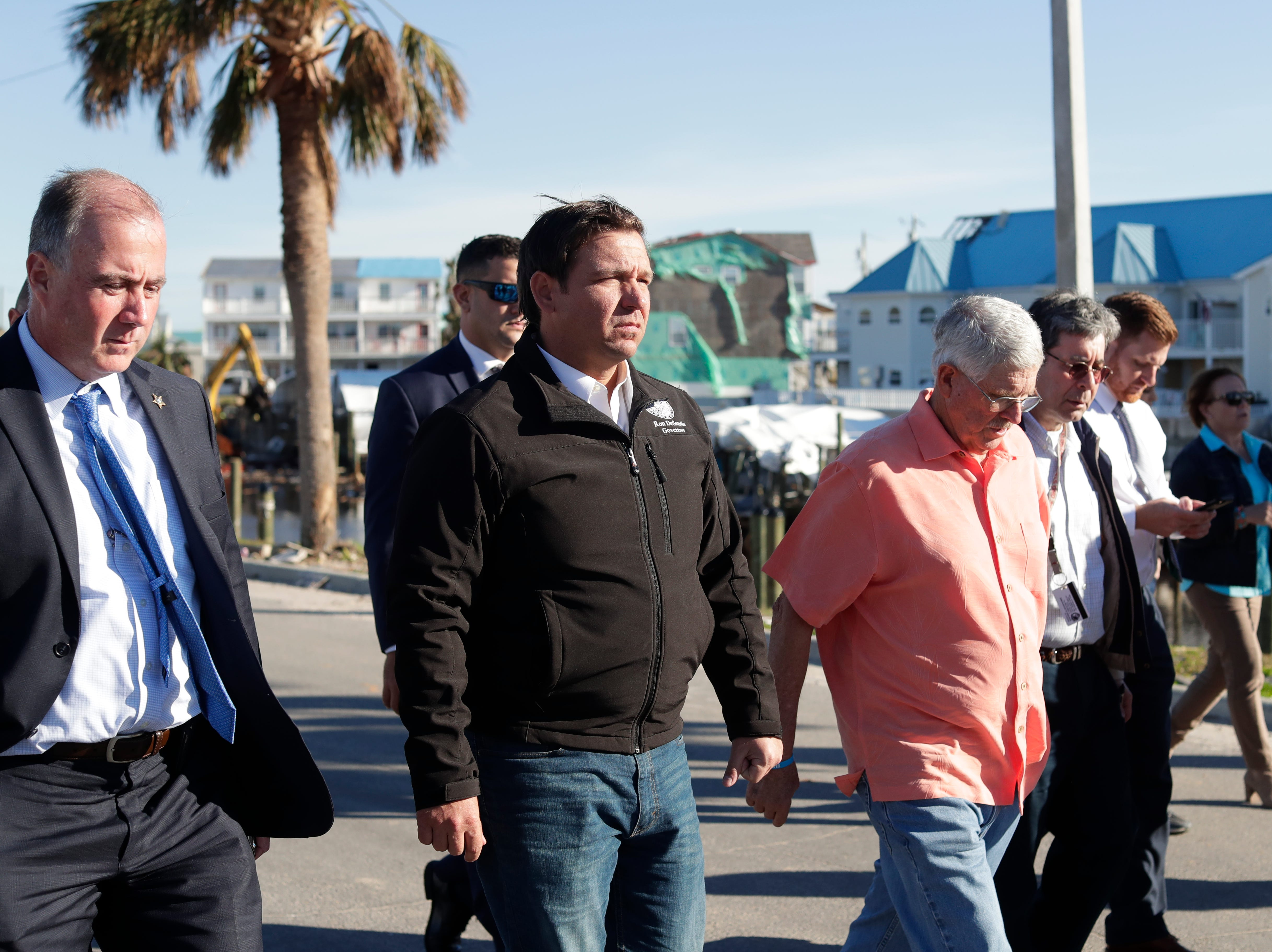 Gov. Ron DeSantis, center, and Mexico Beach Mayor Al Cathey, right, walk the streets of Mexico Beach, Wednesday, Jan. 9, 2019. Hurricane Michael left the panhandle in a total disarray on Oct. 10, 2018.