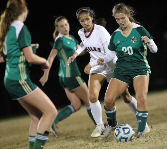 Lincoln senior defender Katherine Whichel passes away from Chiles' Alex Brown as the Trojans beat the Timberwolves 2-1 on Jan. 9, 2019.