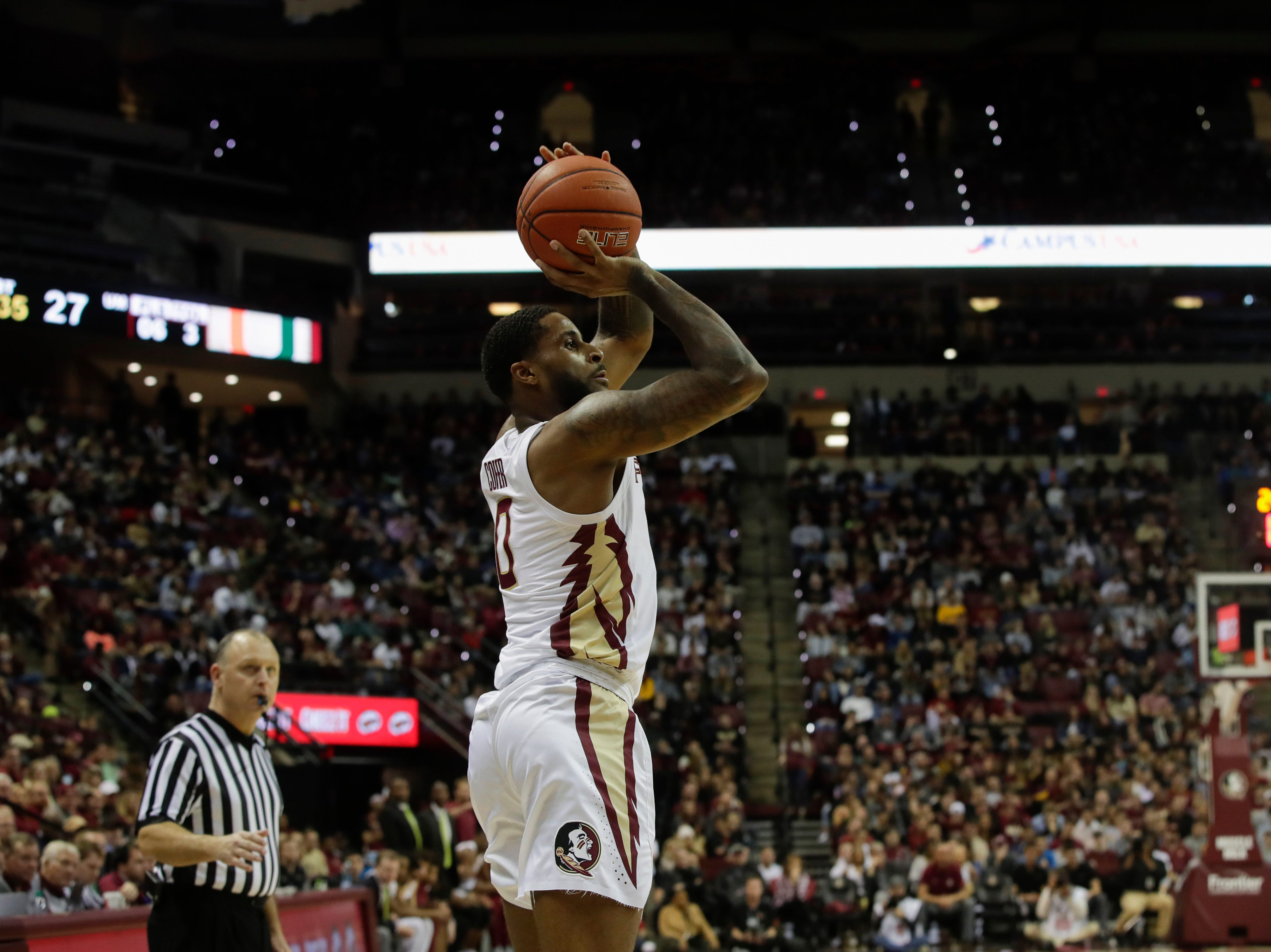 Florida State Seminoles forward Phil Cofer (0) shoots a jumper during a game between FSU and University of Miami Wednesday, Jan. 9, 2019.