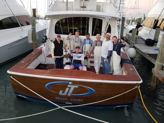 JT led by Capt. Mark McDevitt (third from left) won Thursday's daily award with a record 41 sailfish caught and released in the Pelican Yacht Club Invitational Billfish Tournament.