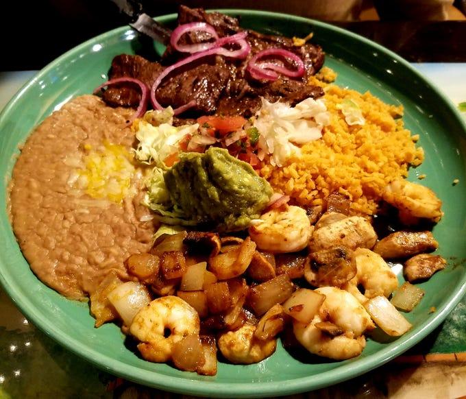 The Guadalajara combo consisted of skirt steak, garlic shrimp, refried beans, and rice at La Marimba in Stuart.