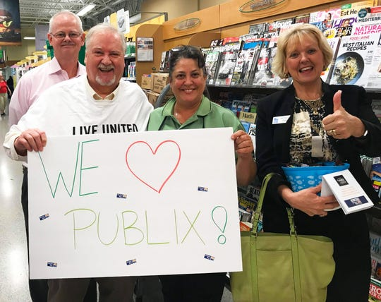 Michael Kint, second from left, CEO of United Way of Indian River County, with Publix and United Way colleagues.