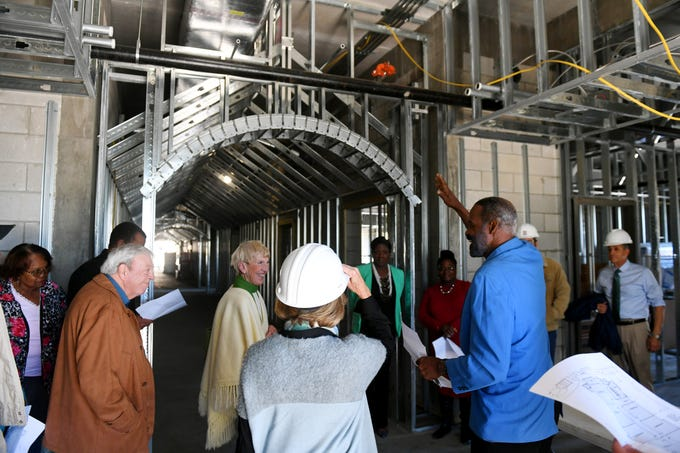 "Freddie Woolfork (right), public relations and facilities operations director for the Gifford Youth Achievement Center, gives a tour of the new expansion project currently under construction on Thursday, Jan. 10, 2019 to a group of about 30 people. The 14,000-square-foot expansion will add eight multipurpose learning rooms, including a computer lab and two rooms geared toward teenagers. ""The building will be used for our middle and high school after school program that has doubled in population over the last few years,"" said Angelia Perry, executive director for the center. ""The new building will allows us to serve an additional 140 kids than we are currently serving bring us to about 300 kids annually."""
