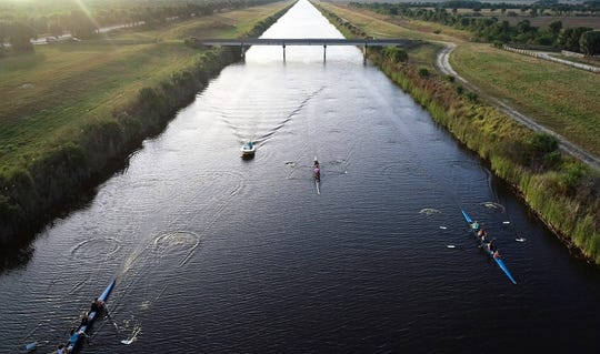 The Sebastian River High School crew teams practice on the C-54 Canal on Wednesday, Jan. 9, 2019, in Fellsmere. Many collegiate rowing teams have chosen to have winter training camps on the Treasure Coast. Joining Yale this year were Georgetown University, Grand Valley State University, Boston College and Rutgers.