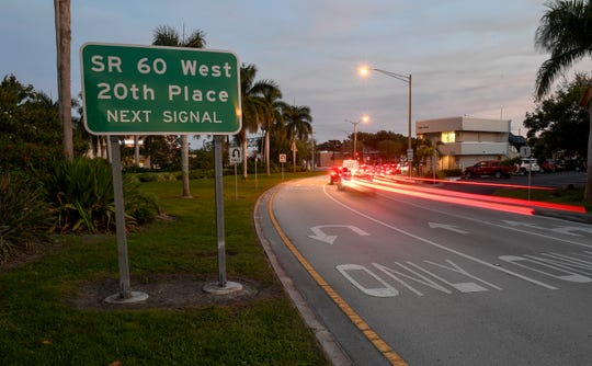 Traffic flows past a street sign in the 800 block of 21st Street on Thursday, Jan. 3, 2019, the area where Carla Dascenzo, 36, of Vero Beach, was killed in single car crash on Saturday, Aug. 5, 2018, in Vero Beach. Dascenzo was driving her 2007 Mustang on 21st Street when the car left the roadway where the road bends southbound, connecting with U.S. 1, and struck a palm tree.