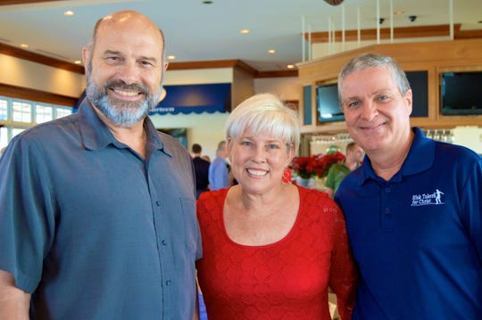 Don Burzynski of Crosslife Counseling, left, Vero Beach Christian Business Association President Maureen Nicolace, and Dale Glading of Risk Takers for Christ.