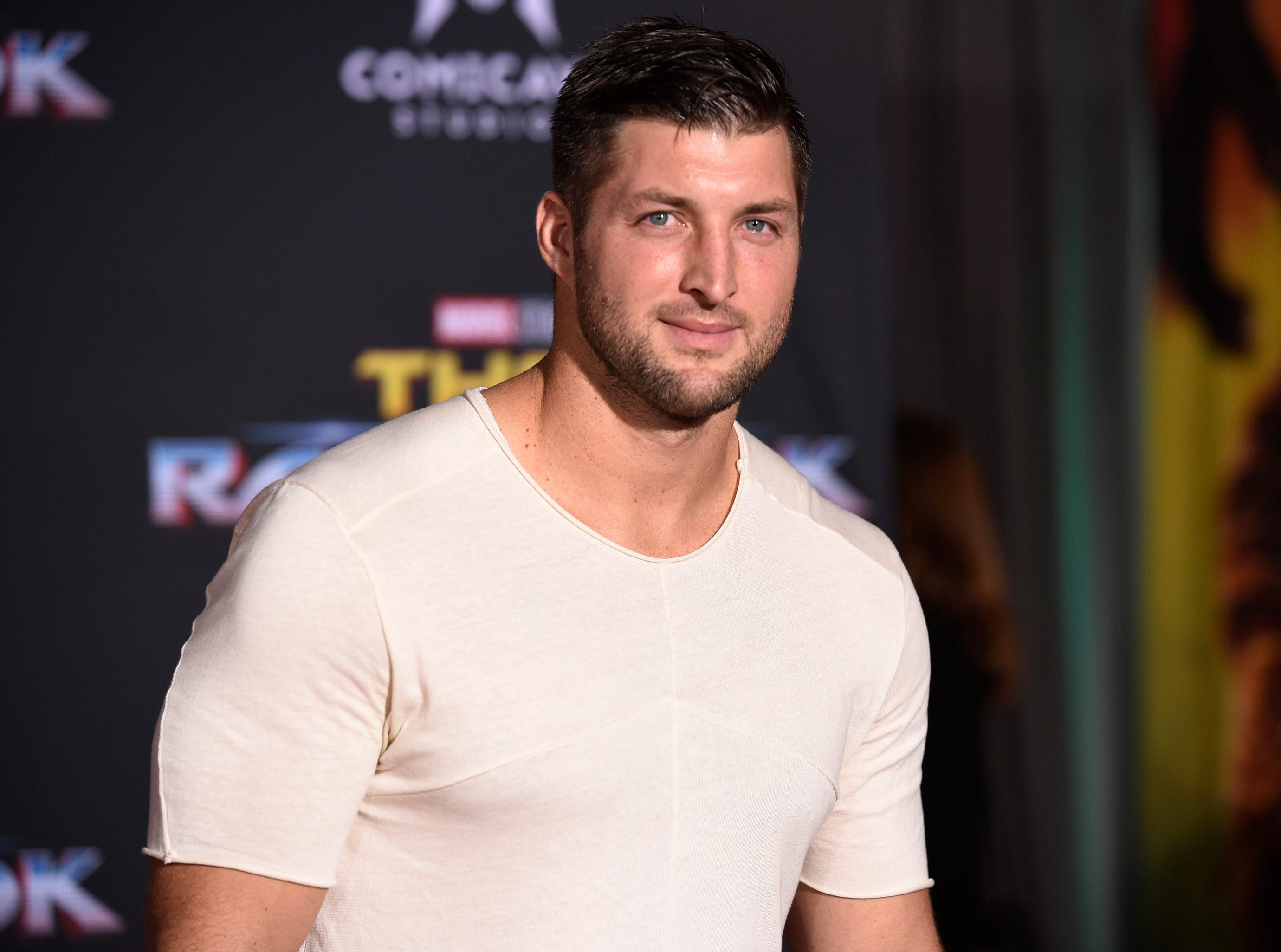 """In this Tuesday, Oct. 10, 2017 file photo, Tim Tebow arrives at the world premiere of """"Thor: Ragnarok"""" at the El Capitan Theatre in Los Angeles. The former Denver Broncos and University of Florida quarterback announced his engagement on Instagram on Thursday, Jan. 10, 2019 to Demi-Leigh Nel-Peters, a South Africa native and the 2017 Miss Universe."""