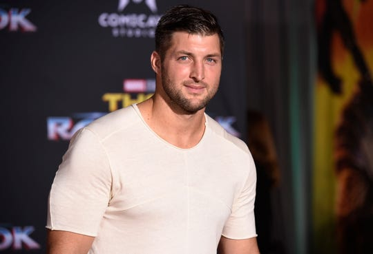 "In this Tuesday, Oct. 10, 2017 file photo, Tim Tebow arrives at the world premiere of ""Thor: Ragnarok"" at the El Capitan Theatre in Los Angeles. The former Denver Broncos and University of Florida quarterback announced his engagement on Instagram on Thursday, Jan. 10, 2019 to Demi-Leigh Nel-Peters, a South Africa native and the 2017 Miss Universe."