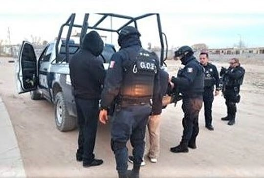 Police speak to a man during a large-scale operation in the Riberas del Bravo neighborhood along the border in Juárez, Mexico.