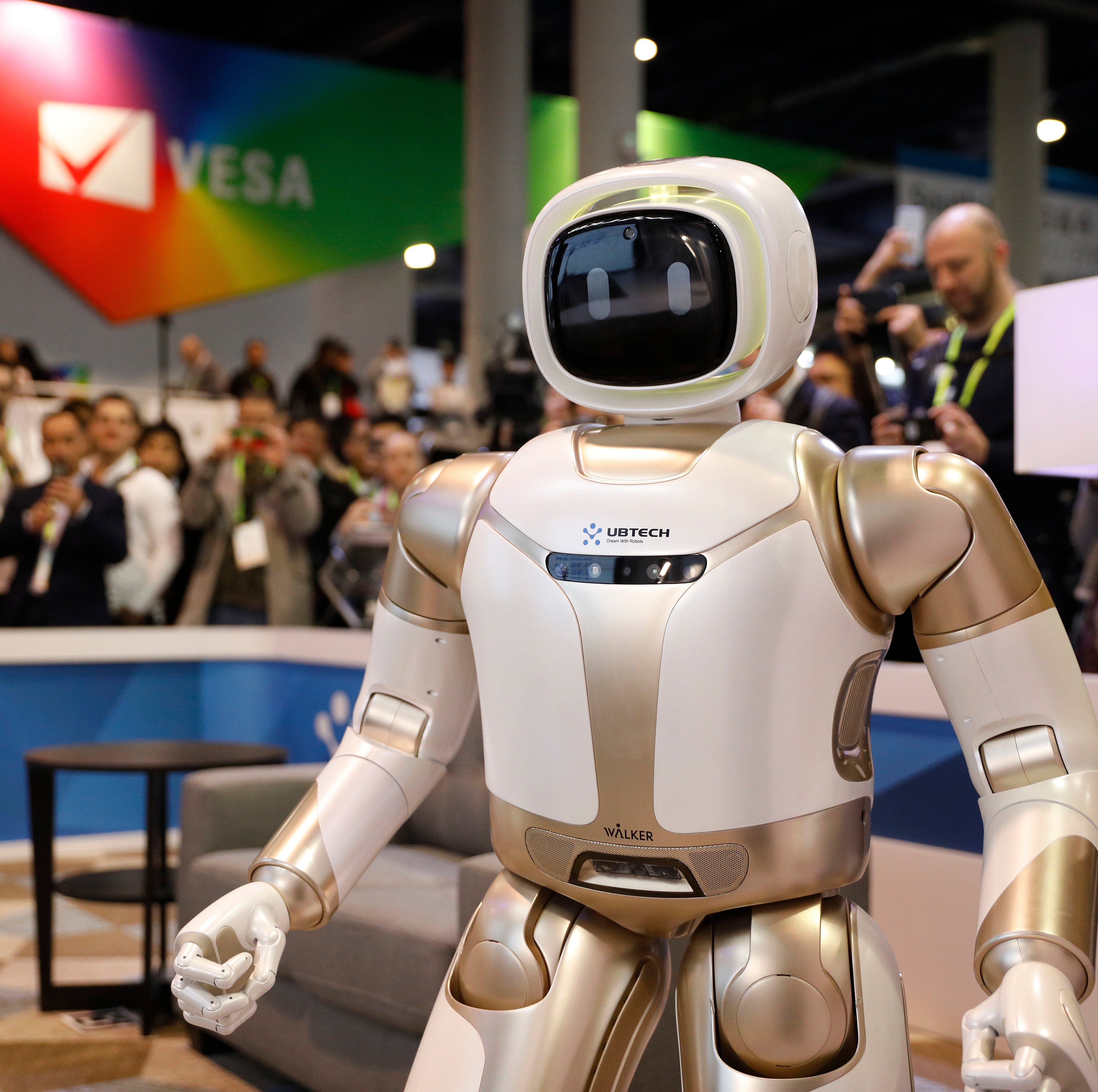 Robots walk, talk, pour beer and take over CES tech show in Las Vegas