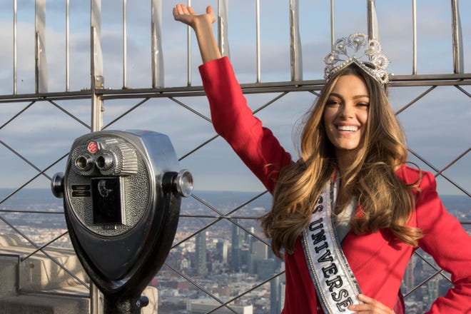 In this Tuesday, Nov. 28, 2017, file photo, Miss Universe 2017 Demi-Leigh Nel-Peters, of South Africa, poses for photographers on the 86th Floor Observation Deck of the Empire State Building in New York. Former Denver Broncos and University of Florida quarterback Tim Tebow is engaged to her. The Heisman Trophy winner announced the engagement on Instagram Thursday, Jan. 10, 2019. She is a South Africa native.