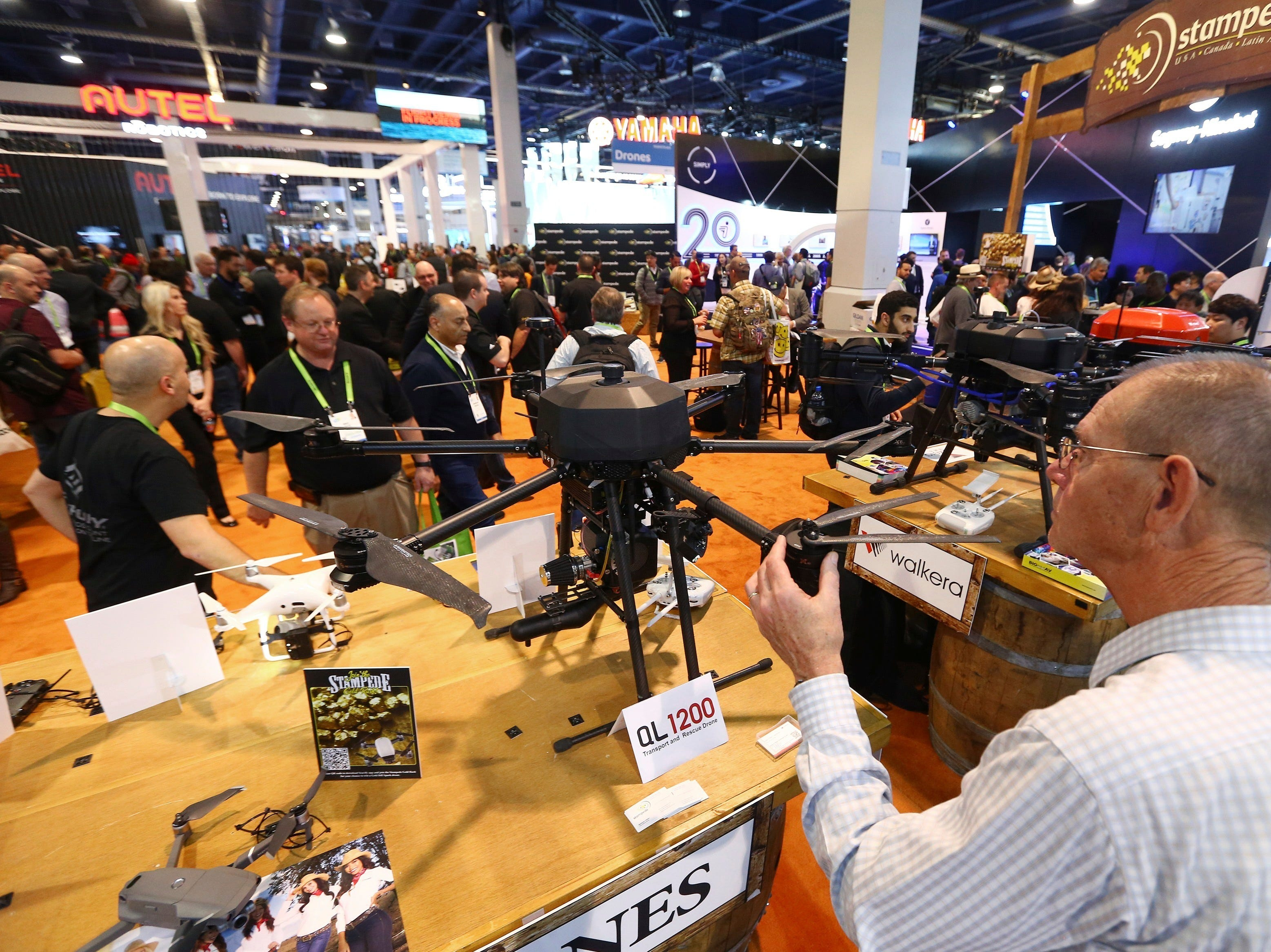 A CES attendee checks out a Walkera QL-1200 drone at CES International on Wednesday, Jan. 9, 2019, in Las Vegas.