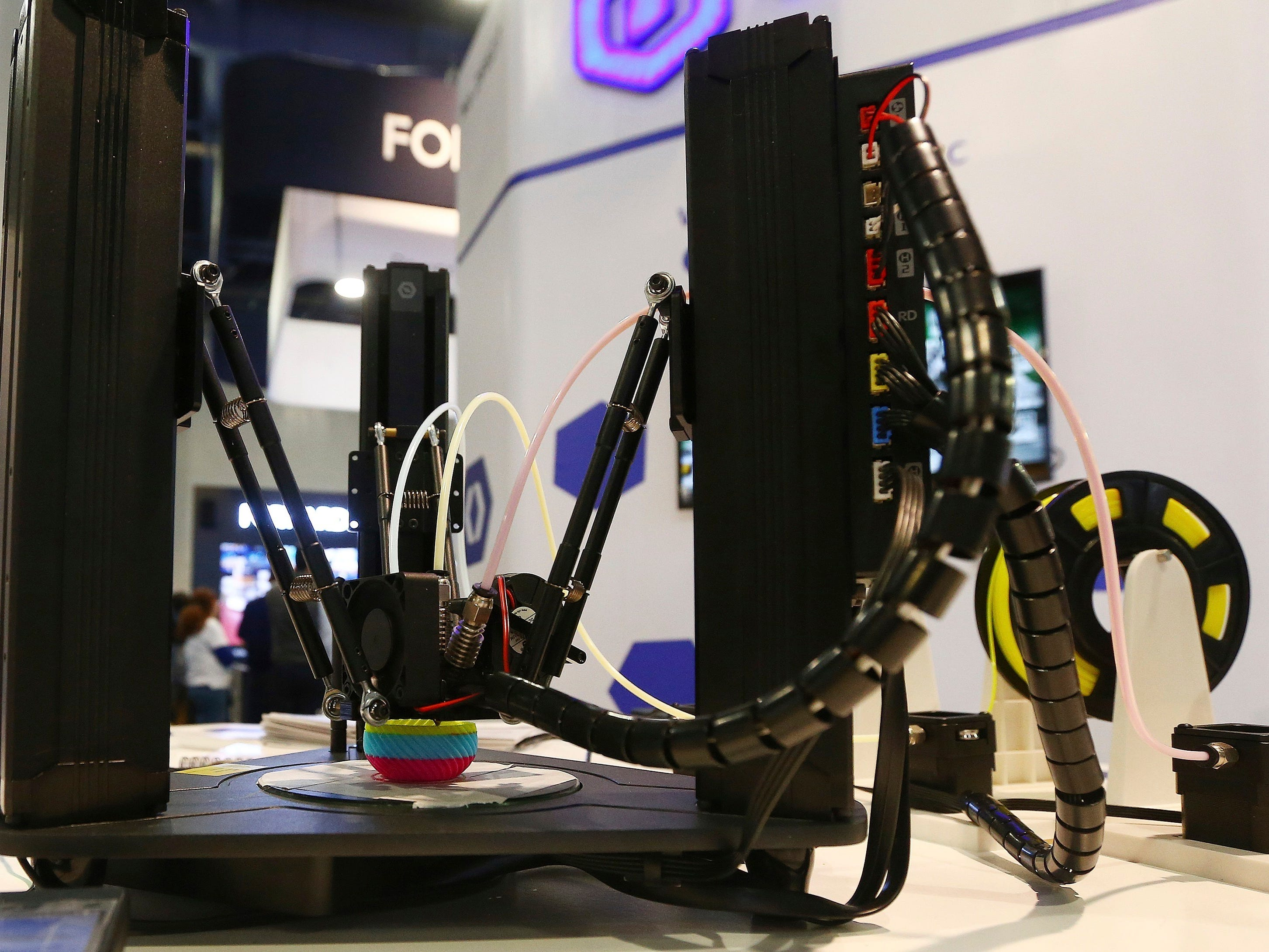 The Dobot Mooz color-mix 3D printer works on a new project at CES International on Wednesday, Jan. 9, 2019, in Las Vegas.