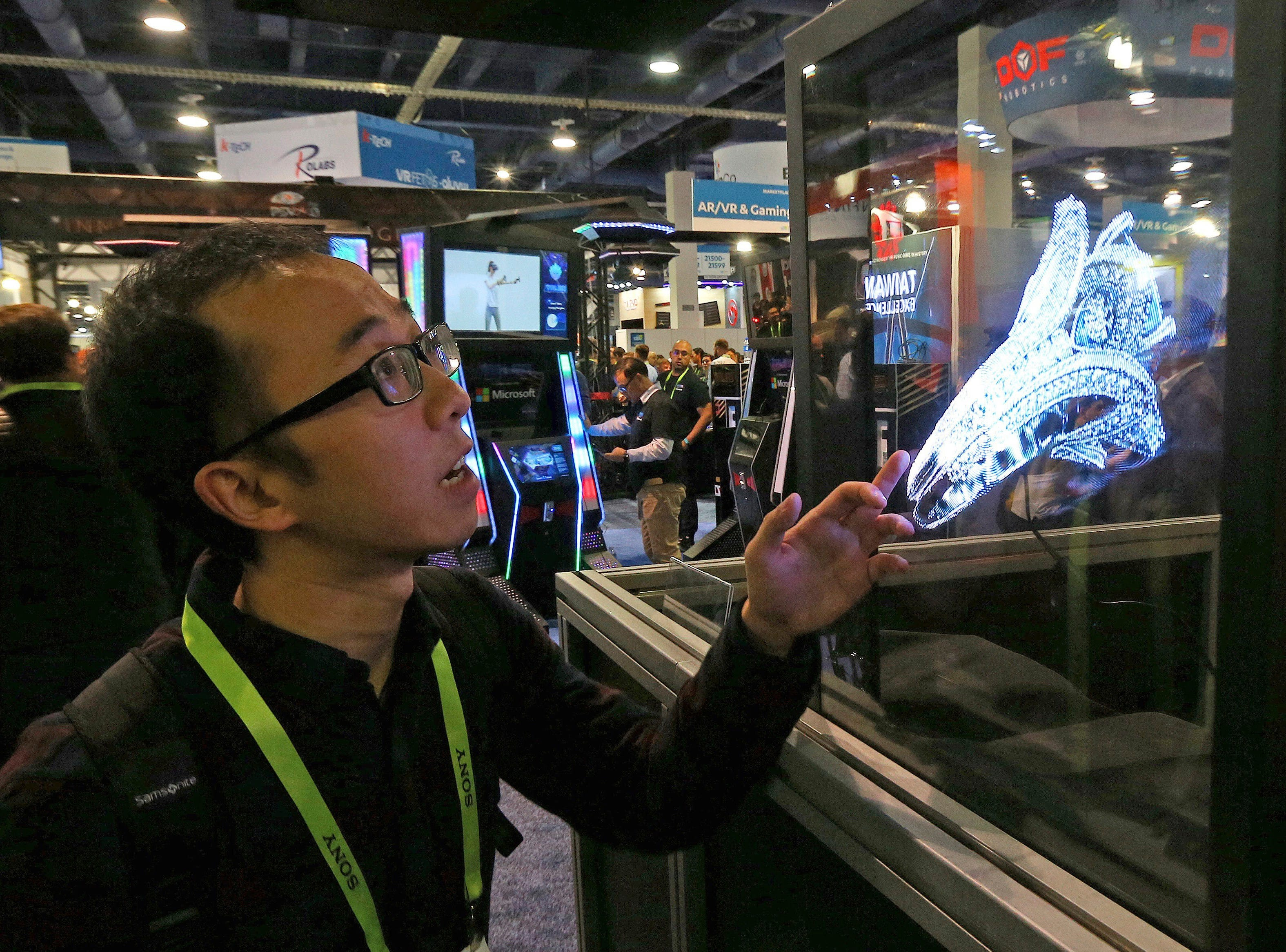 A CES attendee checks out a Hologruf 3D hologram at CES International on Wednesday, Jan. 9, 2019, in Las Vegas.