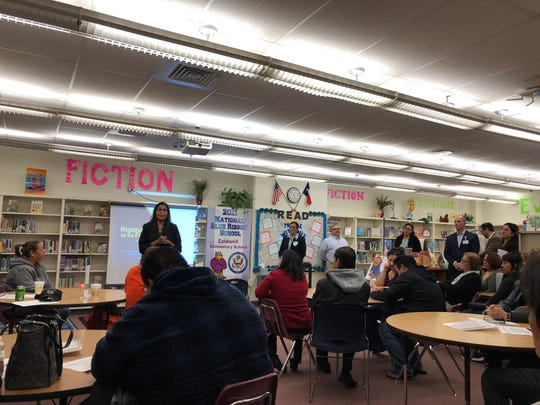 Parents at Alta Vista Elementary School listen as EPISD administrators give presentations on why the campus is being proposed for closure at the end of the school year at a community meeting Wednesday, Jan. 9, 2019, in Central El Paso.