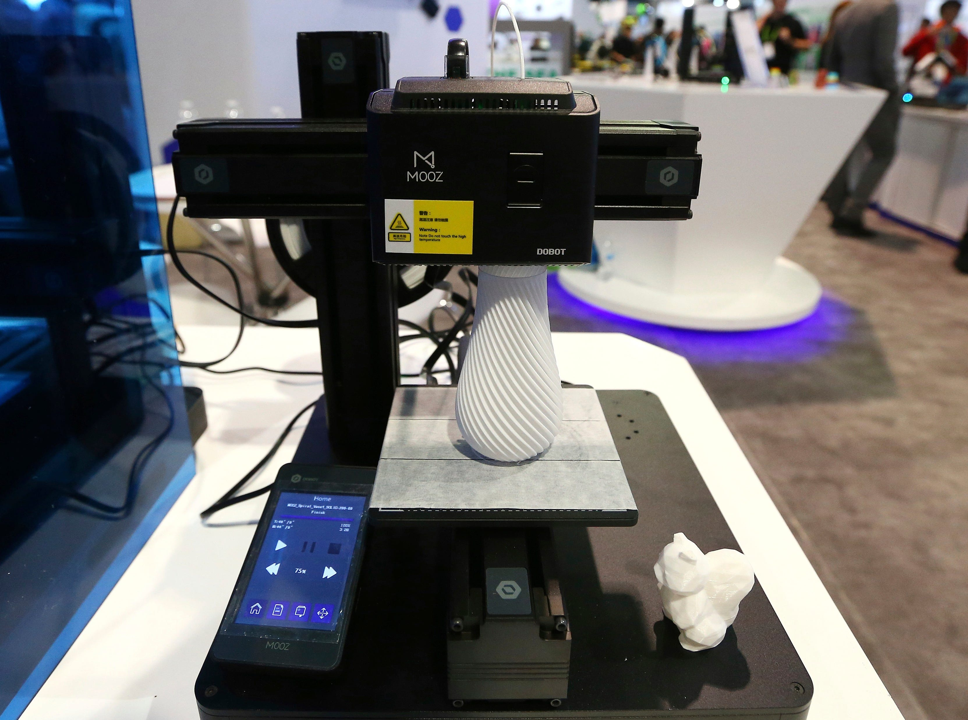 The Dobot Mooz multifunctional modular 3D printer works on a new project at CES International on Wednesday, Jan. 9, 2019, in Las Vegas.