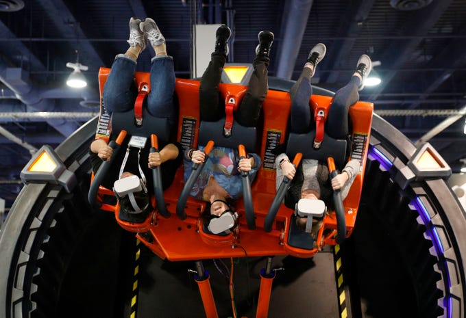 People ride the Hurricane VR 360 at the DOF Robotics booth at CES International on Wednesday, Jan. 9, 2019, in Las Vegas.