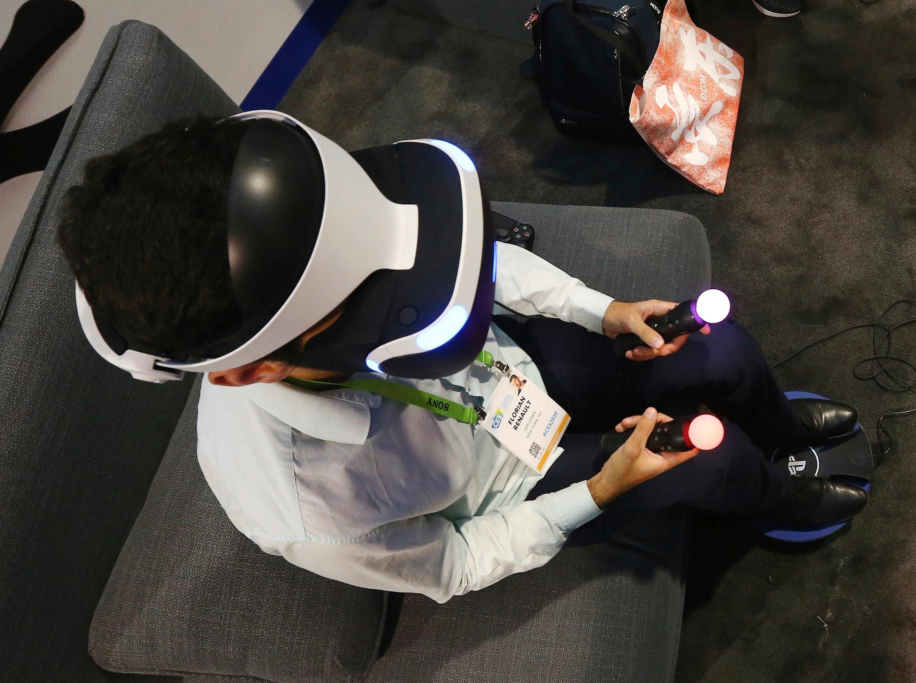 A CES attendee tries out the 3dRudder for foot-powered gaming and VR motion at CES International on Wednesday, Jan. 9, 2019, in Las Vegas.