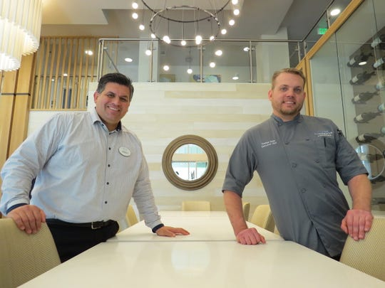"Culinary director Roman Tovar, left, and executive chef Thomas Dado pose with the chef's table at Clearwater at RiverPark, an independent-living community in Oxnard. ""We're just getting our name out there,"" Dado says of participating in the ""Tacos, Treats and Tastings""-themed Oxnard Restaurant Week from Jan. 18-27."