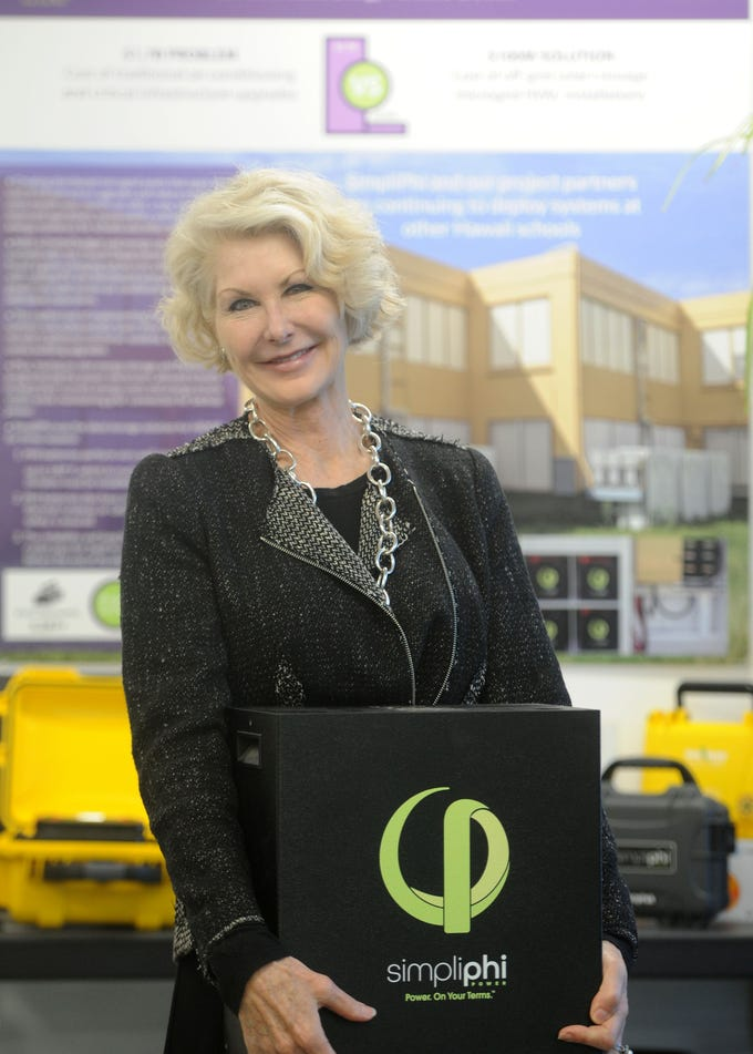 Catherine Von Burg, CEO and president of energy storage technology company SimpliPhi Power, which recently moved into a new manufacturing facility in Oxnard, holds one of the company's  portable batteries. The company, which started in Ojai, is growing and needed more space.