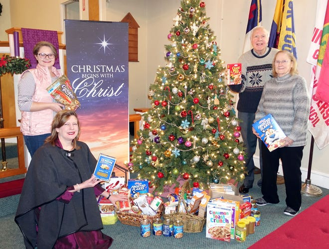 (From left) Val Walters, Alice Mund, Jim Fyan and Elaine Fyan, members of South Vineland United Methodist Church, contributed food items for the food bank as part of the church's advent activities. The church welcomes new members.