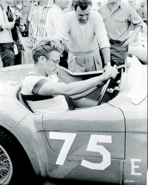 Actor James Dean sits behind the wheel of his newly purchased silver Porsche 550 Spyder, which he was driving when he crashed on Sept. 30, 1955.