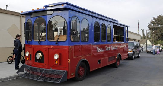 In this file photo, children fill a Visalia trolley with nonperishable food items at Annie Mitchell Elementary School.