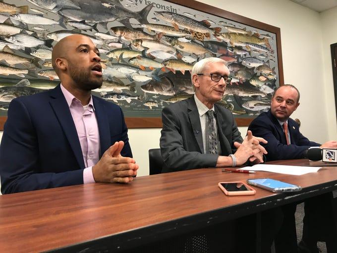 Lt. Gov. Mandela Barnes, left, Gov. Tony Evers and Department of Transportation secretary-designee Craig Thompson speak Thursday at the Wausau DMV.
