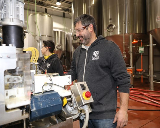 Scott Vaccaro, the founder of Captain Lawrence Brewing Company in Elmsford, is pictured near the canning machines, Jan. 10, 2018.