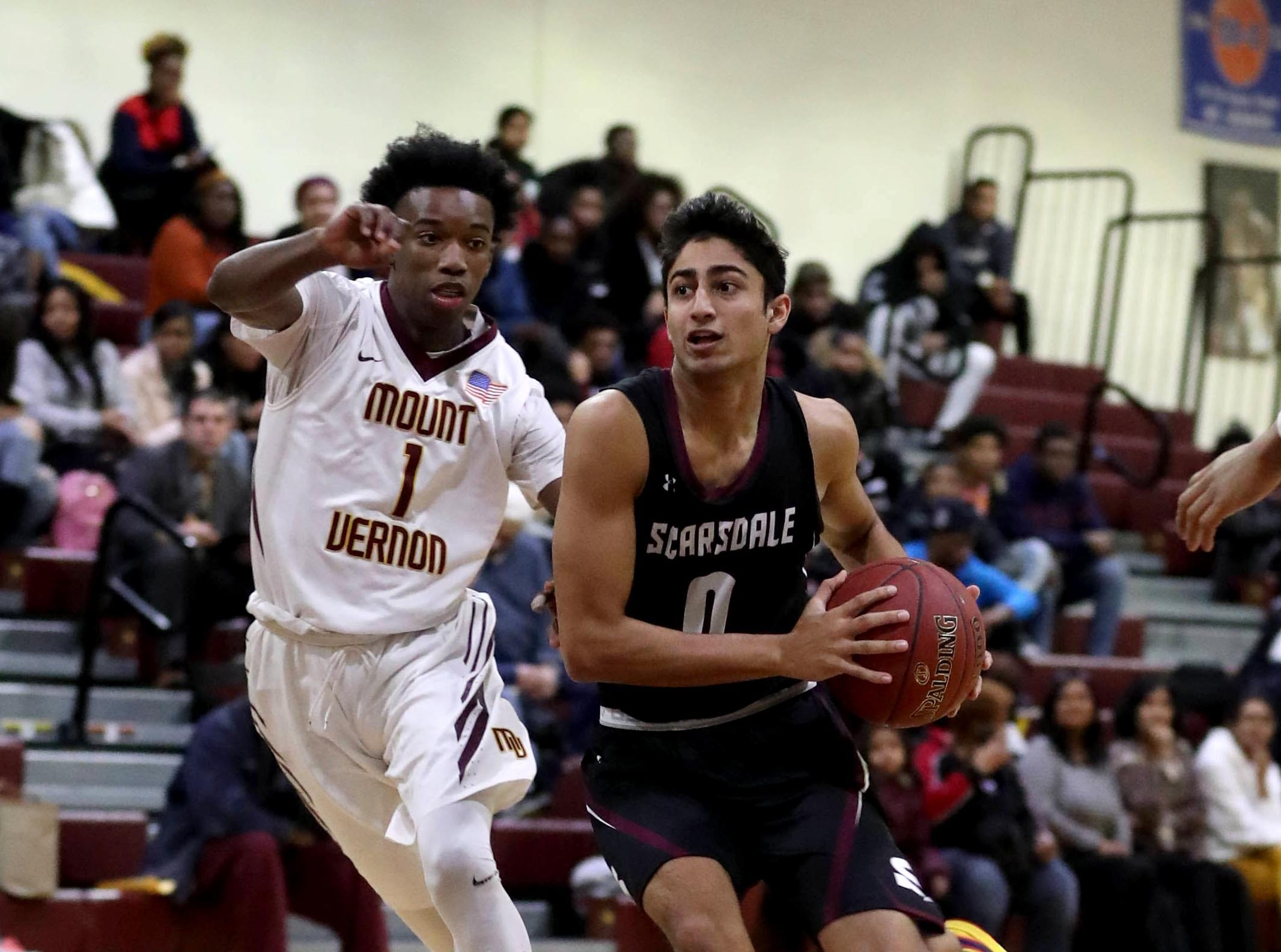 Jayshen Saigal of Scarsdale drives past Irvin Patrick of Mount Vernon during a varsity basketball game at Mount Vernon High School Jan. 9, 2019. Mount Vernon defeated Scarsdale 70-54.