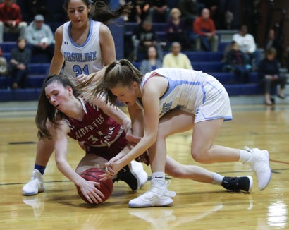 Albertus' Emma Parahus (31) and Ursuline's Alexa Mustafaj (10) go for a loose ball during girls varsity basketball action at The Ursuline School in New Rochelle on Wednesday, January 9, 2019.  Ursuline defeated Albertus 68-48.