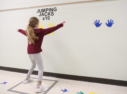 Second grader Leia Egan does jumping jacks along the sensory path in the hallway at Sloatsburg Elementary School in Sloatsburg on Thursday, January 10, 2019.