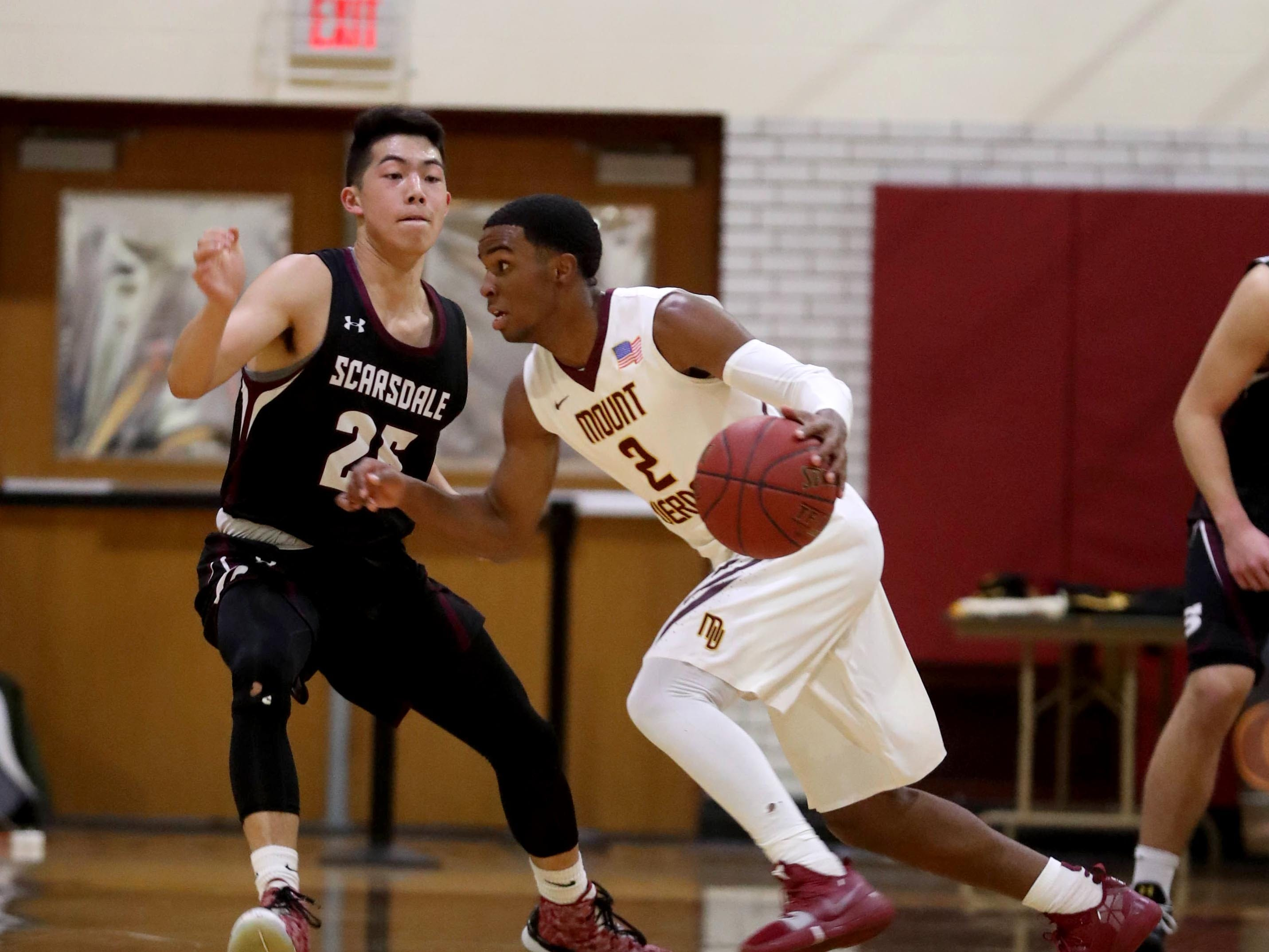 Joel Cooper of Mount Vernon drives on Evan Huo of Scarsdale during a varsity basketball game at Mount Vernon High School Jan. 9, 2019. Mount Vernon defeated Scarsdale 70-54.