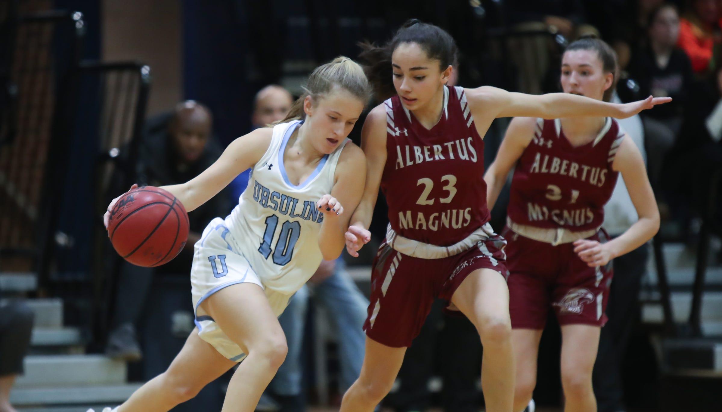 Ursuline's Alexa Mustafaj (10) drives on Albertus' Paulina Paris (23) during girls varsity basketball action at The Ursuline School in New Rochelle on Wednesday, January 9, 2019.  Ursuline defeated Albertus 68-48.
