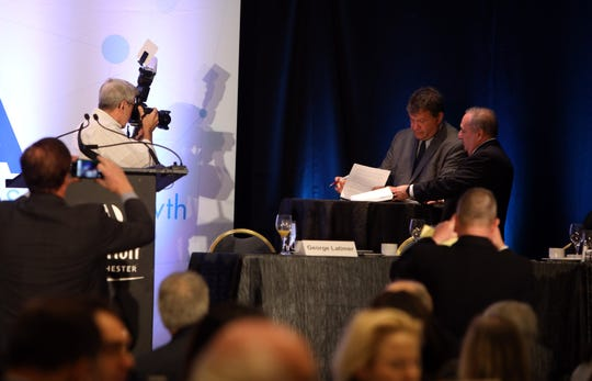 Westchester County Executive George Latimer and John Fareri of Fareri Associates sign the 'North 60' lease after Latimer announced the deal during his annual speech to members of the business organization of the Westchester County Association Jan. 10, 2019 at the Westchester Marriott Hotel.