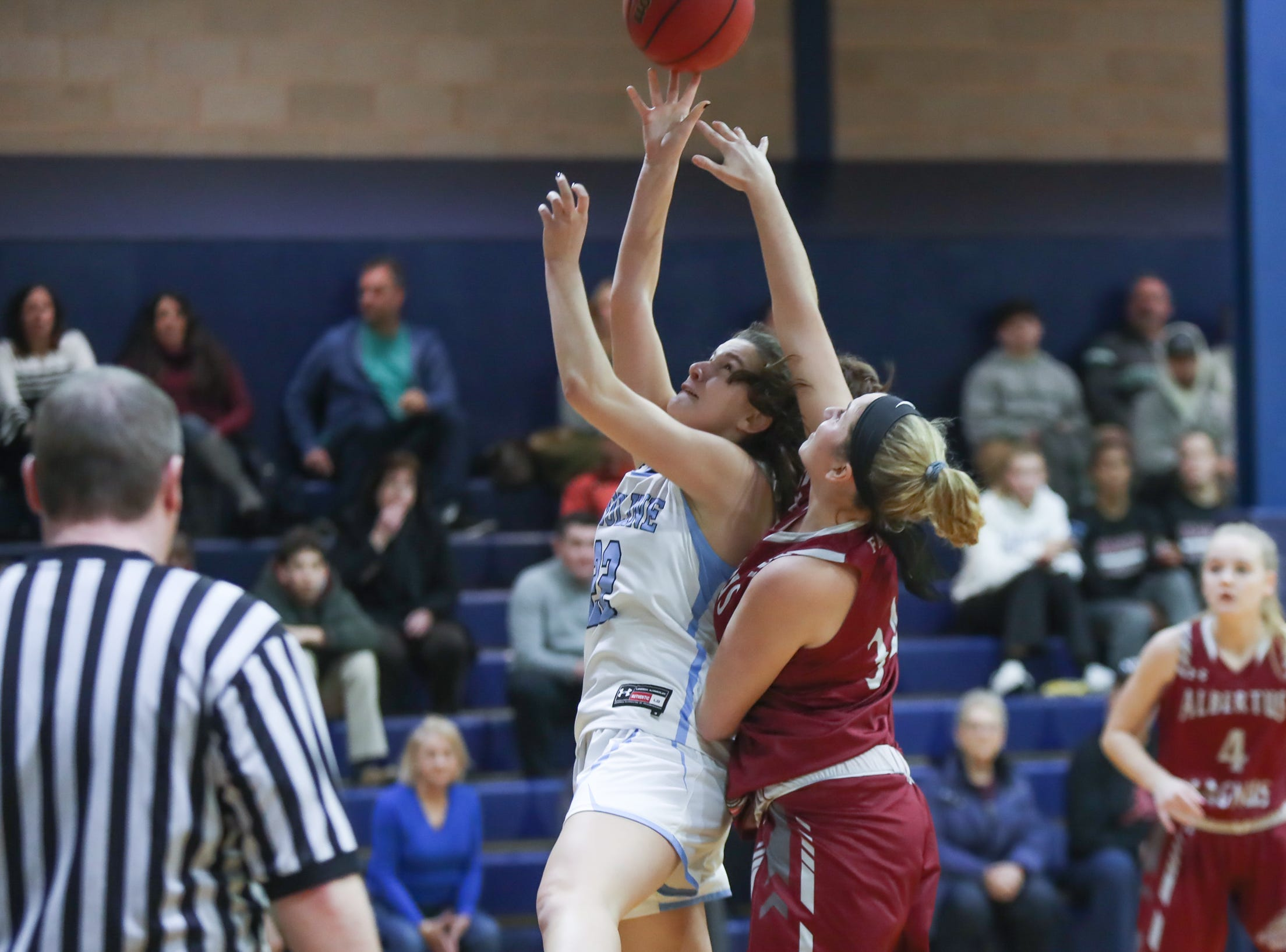 Ursuline's Alexa Quirolo (22) Albertus' Chloe Cavallo (34) during girls varsity basketball action at The Ursuline School in New Rochelle on Wednesday, January 9, 2019.  Ursuline defeated Albertus 68-48.