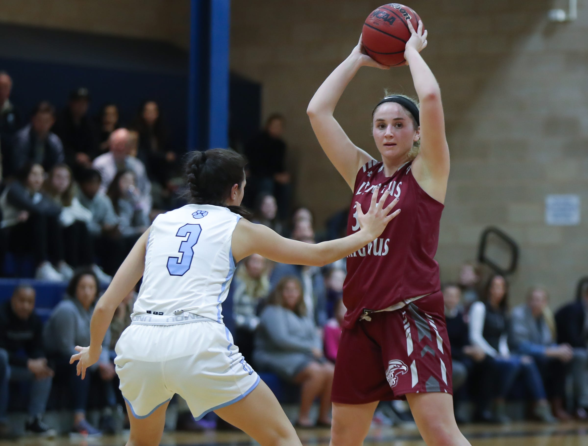 Albertus' Chloe Cavallo (34) looks for a play as Ursuline's Riley DelPriorie (3) defends during girls varsity basketball action at The Ursuline School in New Rochelle on Wednesday, January 9, 2019.  Ursuline defeated Albertus 68-48.