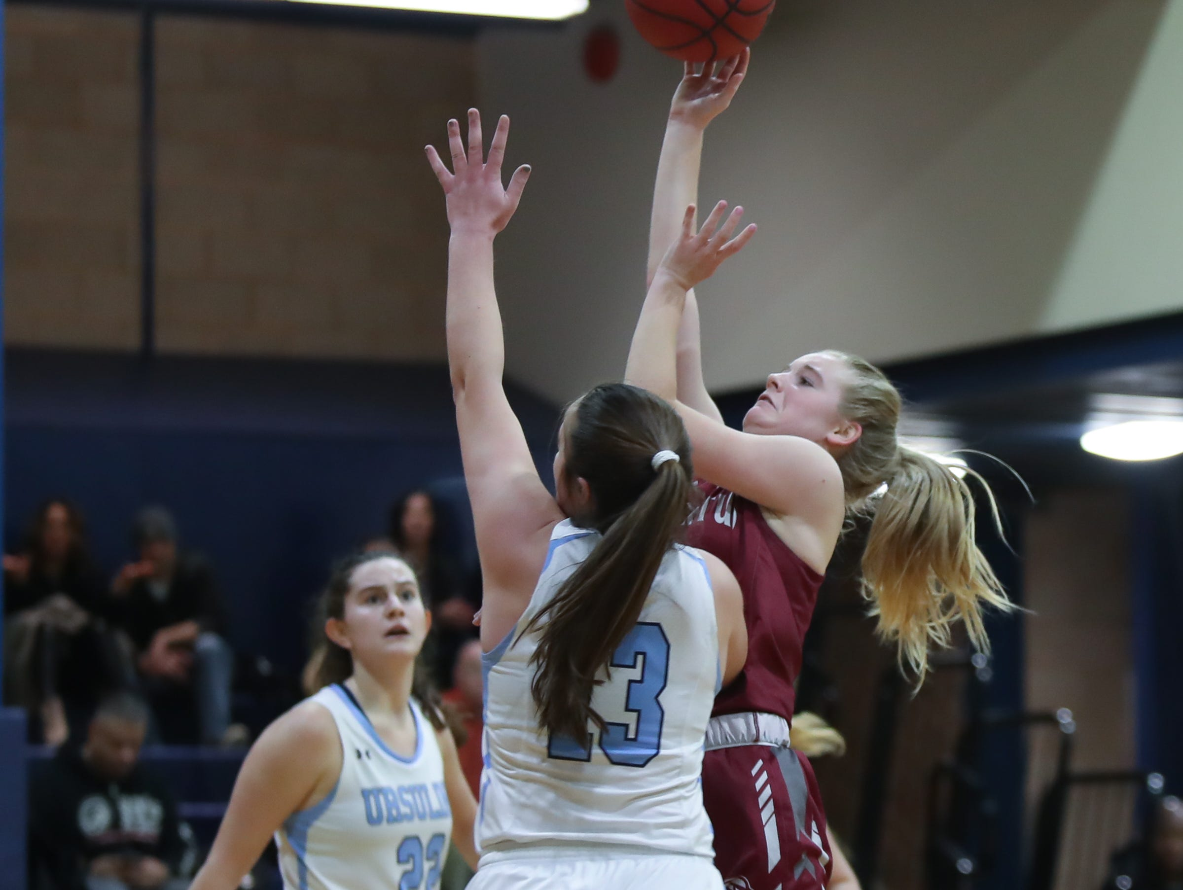 Albertus' Sierra Linnin (4) goes over the top of Ursuline's Jane McCauley (13) during girls varsity basketball action at The Ursuline School in New Rochelle on Wednesday, January 9, 2019.  Ursuline defeated Albertus 68-48.