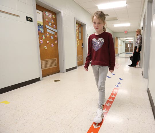 Second grader Leia Egan walks along the sensory path in the hallway at Sloatsburg Elementary School in Sloatsburg on Thursday, January 10, 2019.