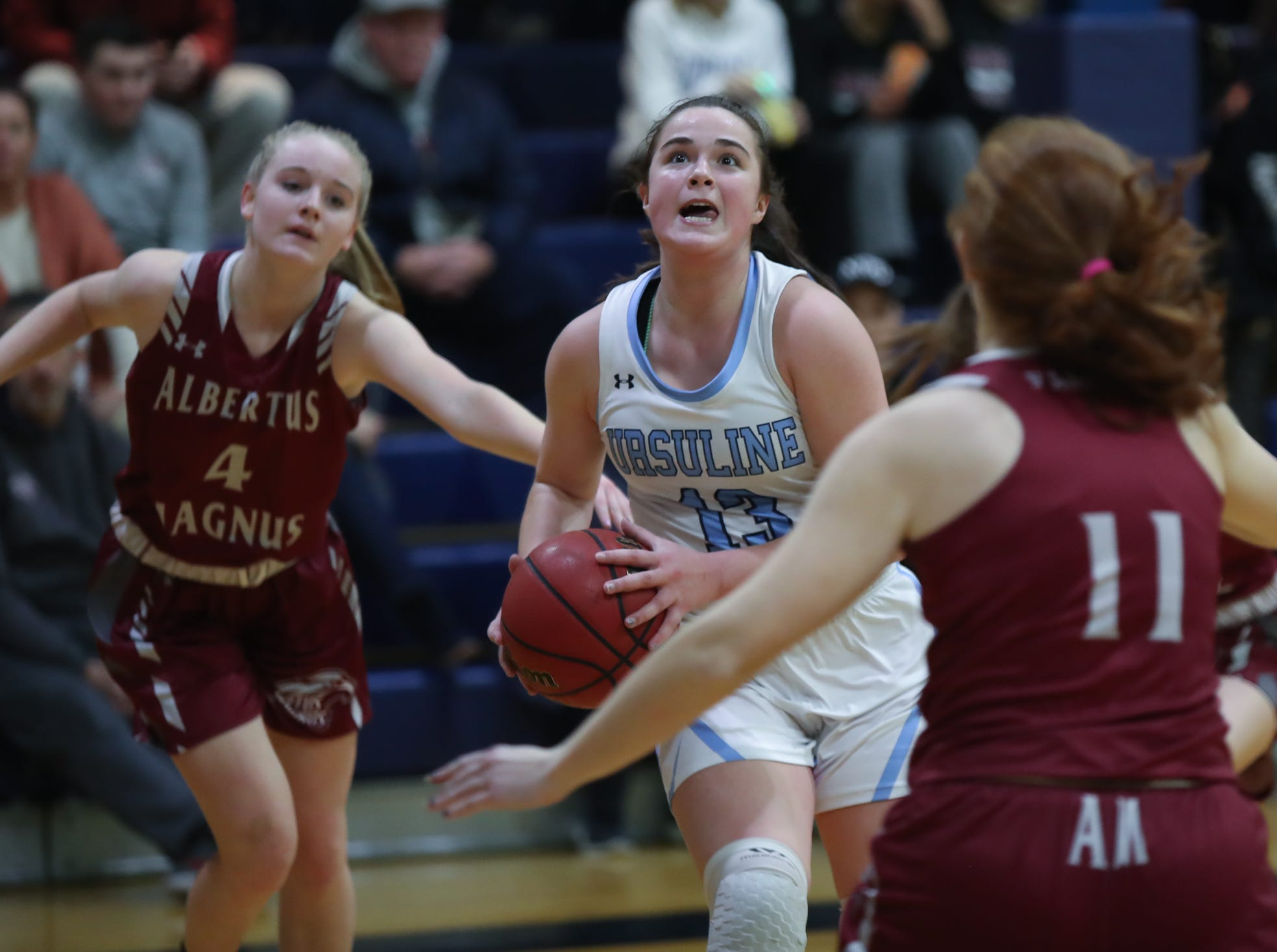Ursuline's Jane McCauley (13) drives to the basket during girls varsity basketball action at The Ursuline School in New Rochelle on Wednesday, January 9, 2019.  Ursuline defeated Albertus 68-48.