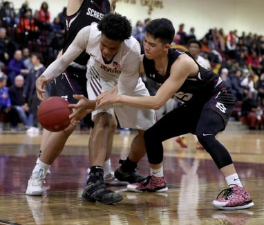 Troy Hupstead of Mount Vernon battles Evan Huo of Scarsdale during a varsity basketball game at Mount Vernon High School Jan. 9, 2019. Mount Vernon defeated Scarsdale 70-54.