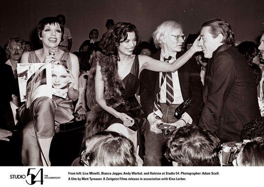 Liza Minelli, Bianica Jagger, Andy Warhol and Halston at Studio 54