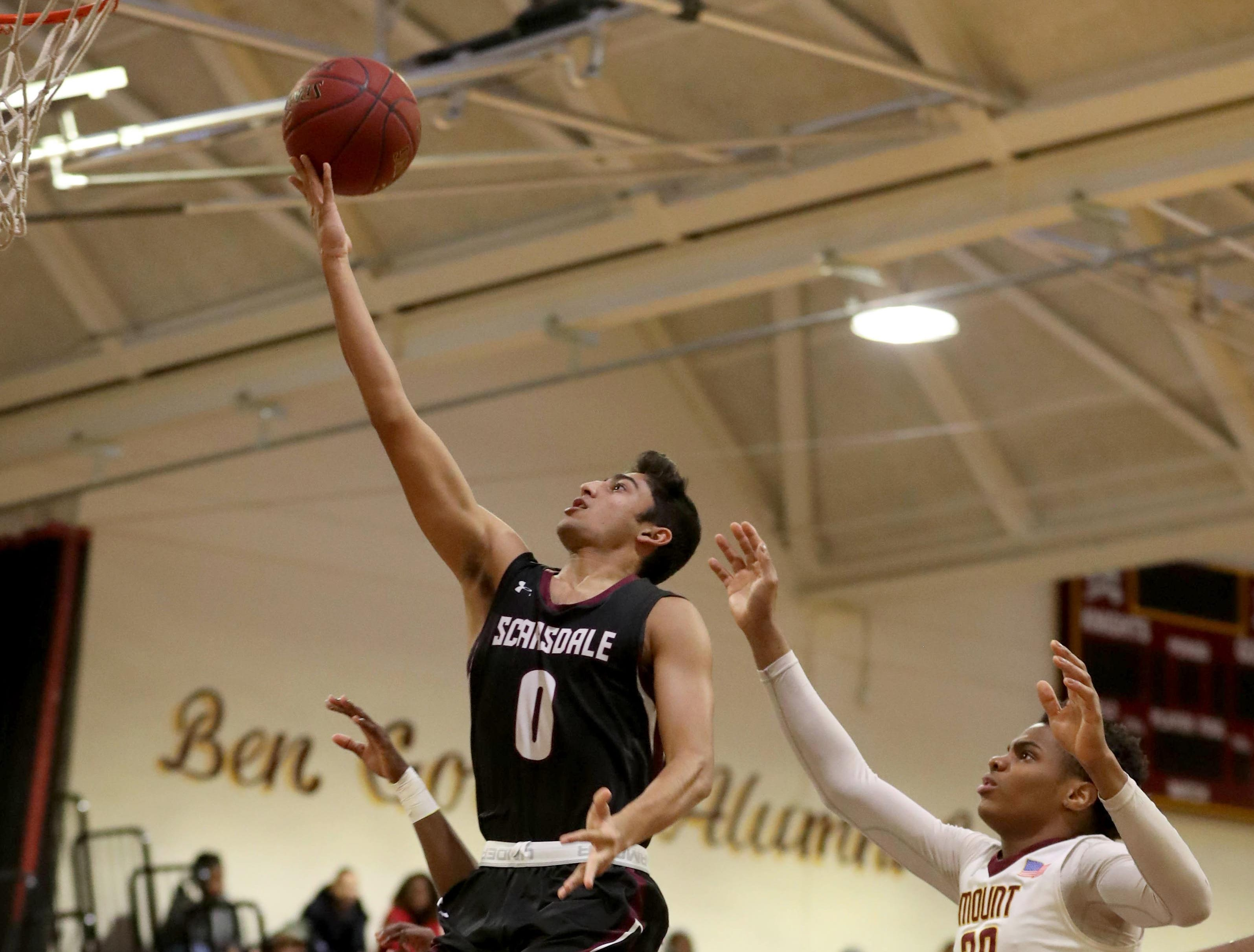 Jayshen Saigal of Scarsdale gets past Troy Hupstead of Mount Vernon during a varsity basketball game at Mount Vernon High School Jan. 9, 2019. Mount Vernon defeated Scarsdale 70-54.