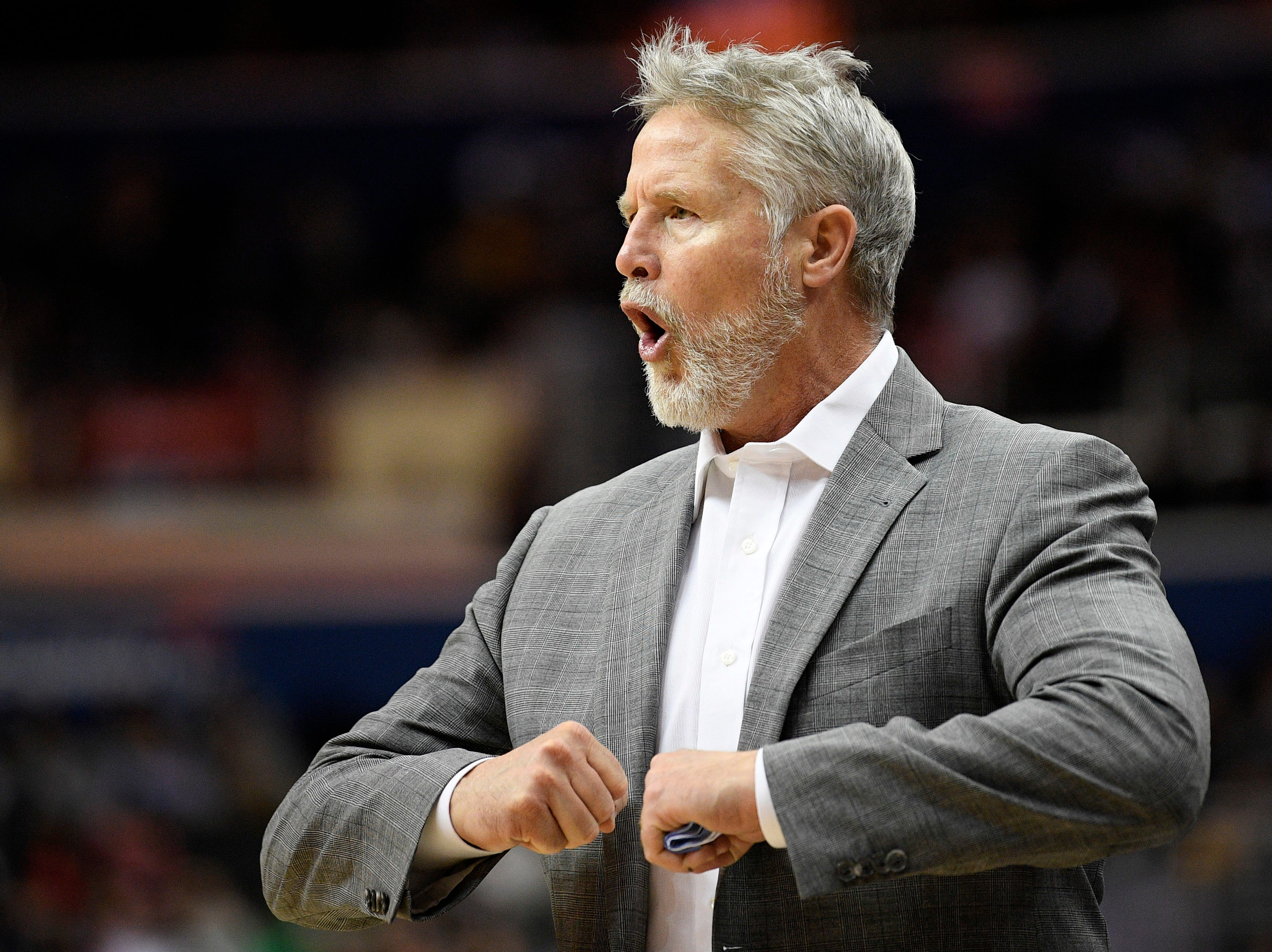 Philadelphia 76ers head coach Brett Brown gestures during the second half of an NBA basketball game against the Washington Wizards, Wednesday, Jan. 9, 2019, in Washington. The Wizards won 123-106. (AP Photo/Nick Wass)