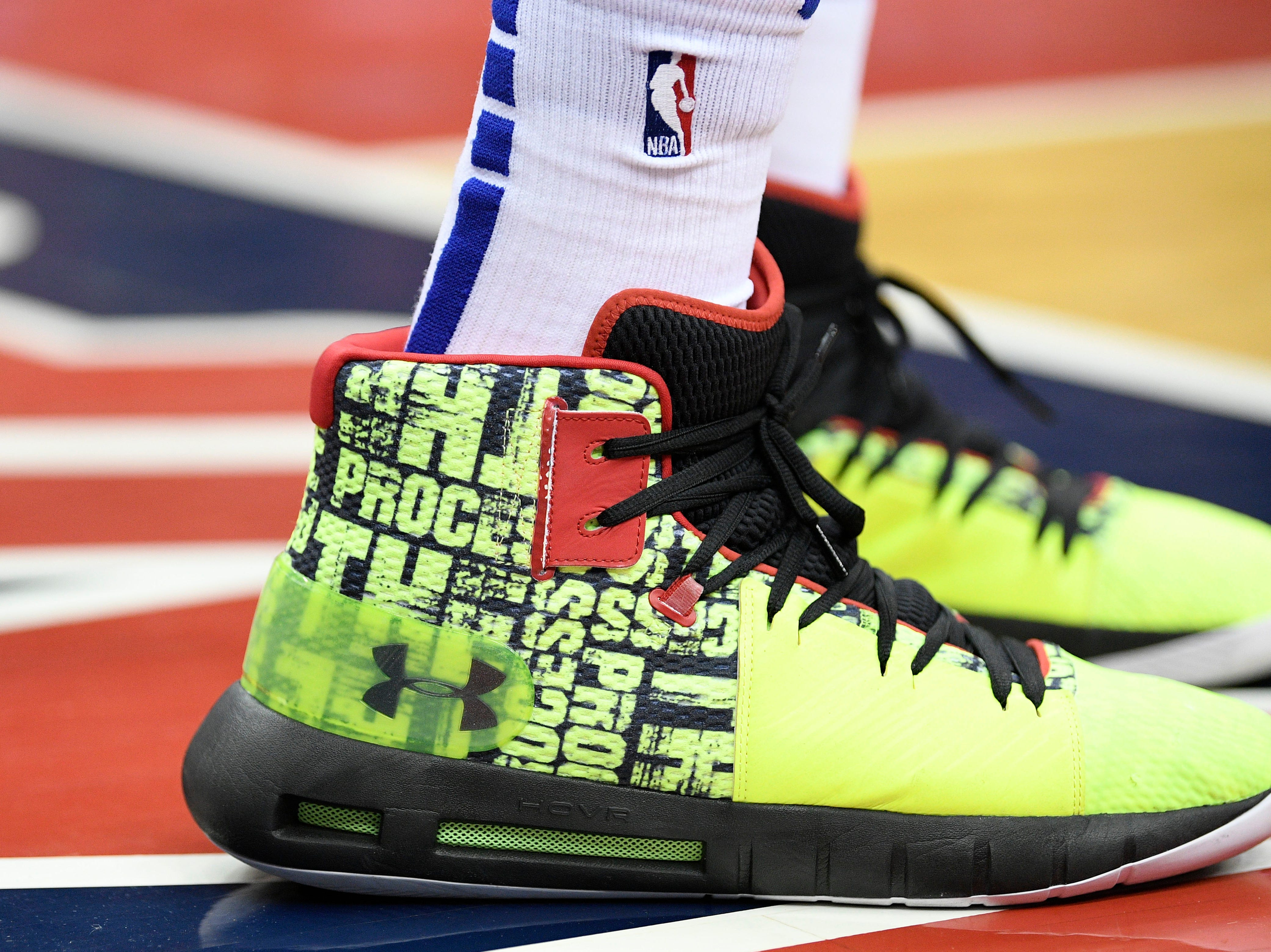 Philadelphia 76ers center Joel Embiid's shoes are seen on the court during the second half of an NBA basketball game against the Washington Wizards, Wednesday, Jan. 9, 2019, in Washington. The Wizards won 123-106. (AP Photo/Nick Wass)