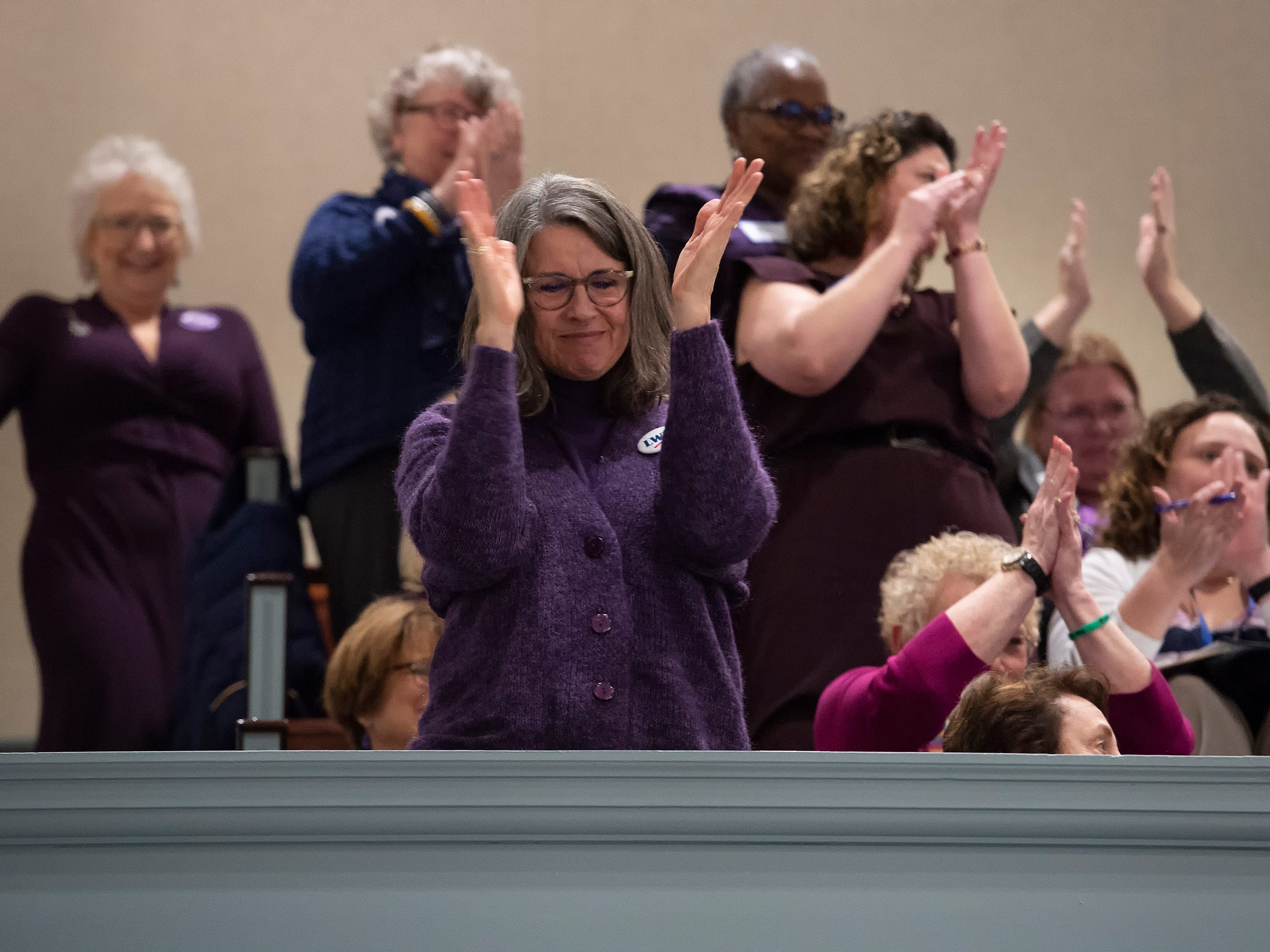 Visitors cheer after the house passes House Bill 1, equal rights amendment to the state constitution, during session at Legislative Hall in Dover.